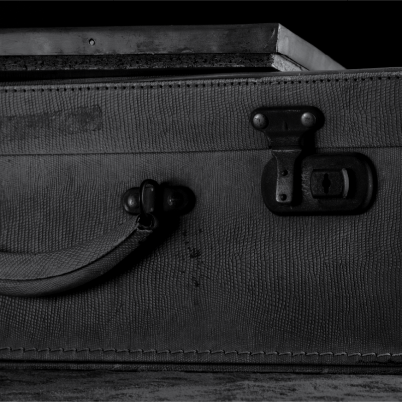 Black and white photo: Suitcase