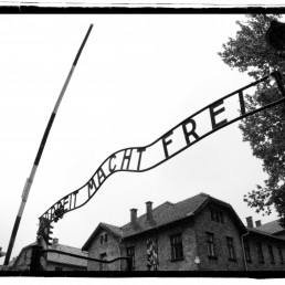 Black and white photo: Gate to death camp